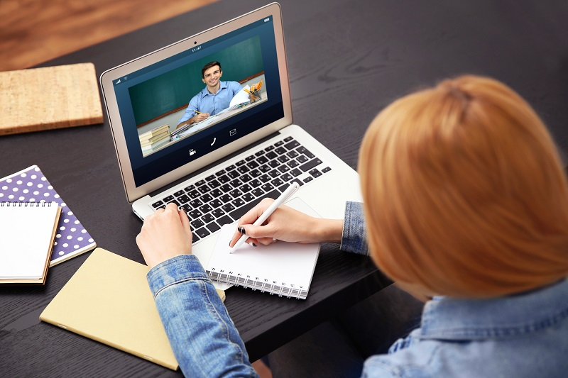 Woman videoconferencing from a laptop