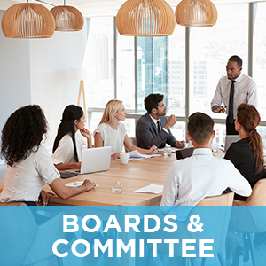Board Members Talking at Table