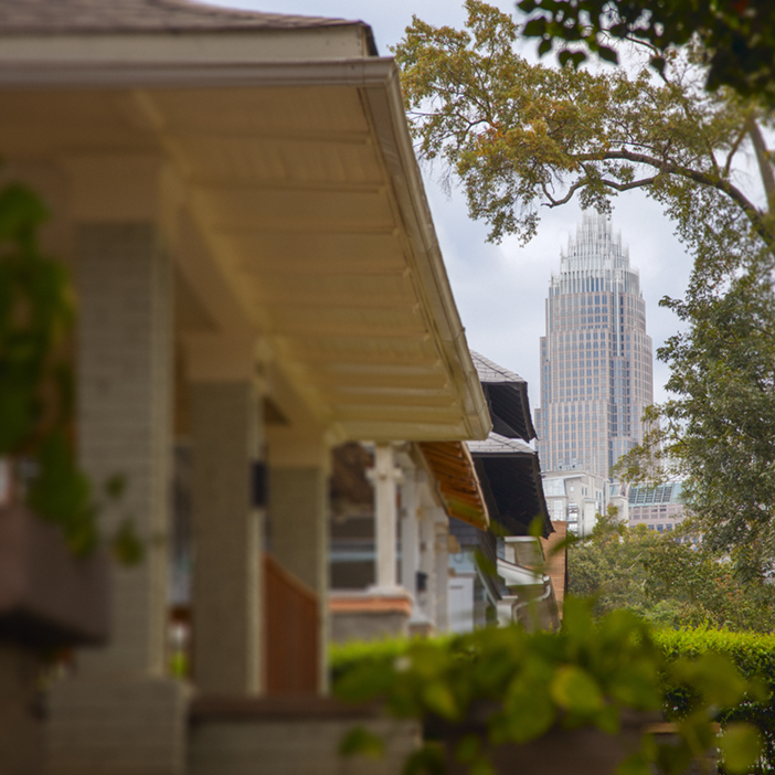 View of Charlotte Skyline in background and front porches in foreground