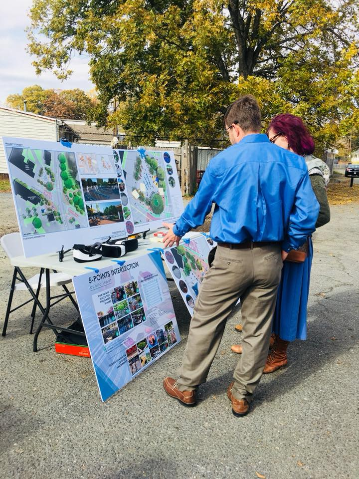 Neighbor looking at information about Five Points project