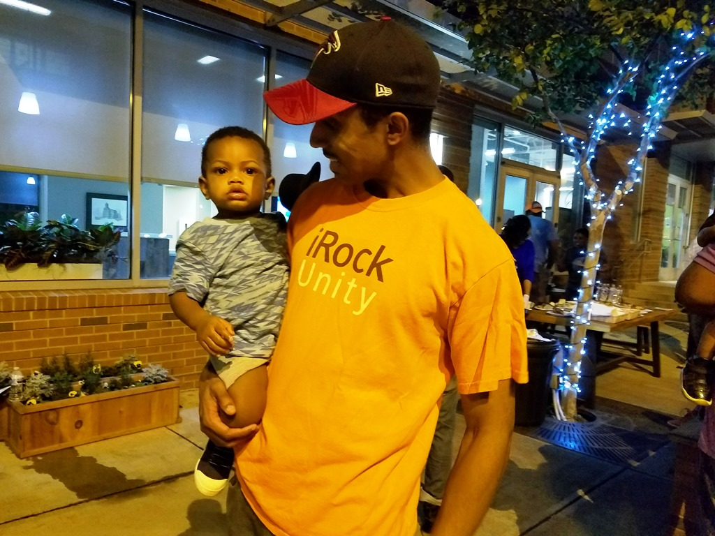 Man holding baby at Better Block event