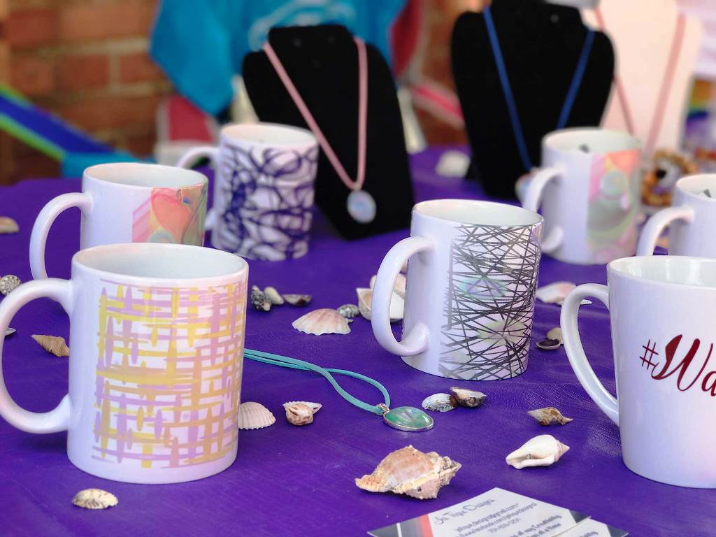 Coffee mugs and jewelry on display