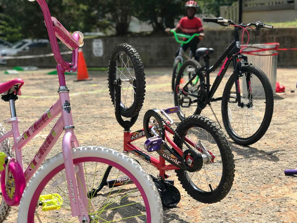 Kids' bicycles parked at Better Block event