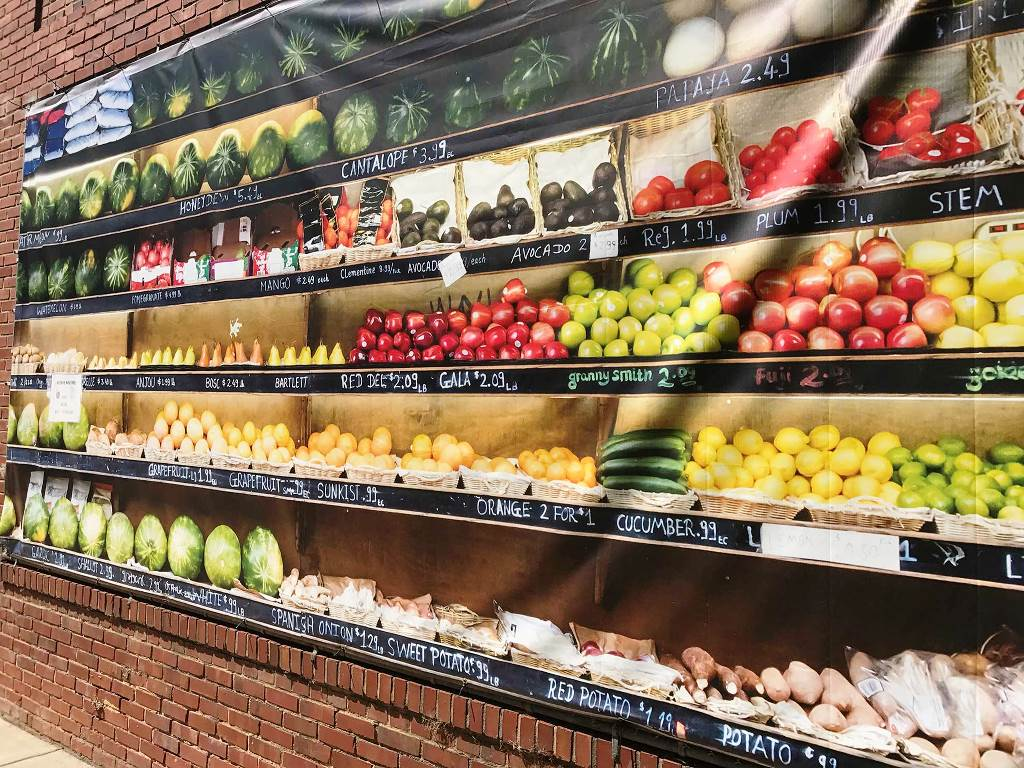 Poster of produce display on wall