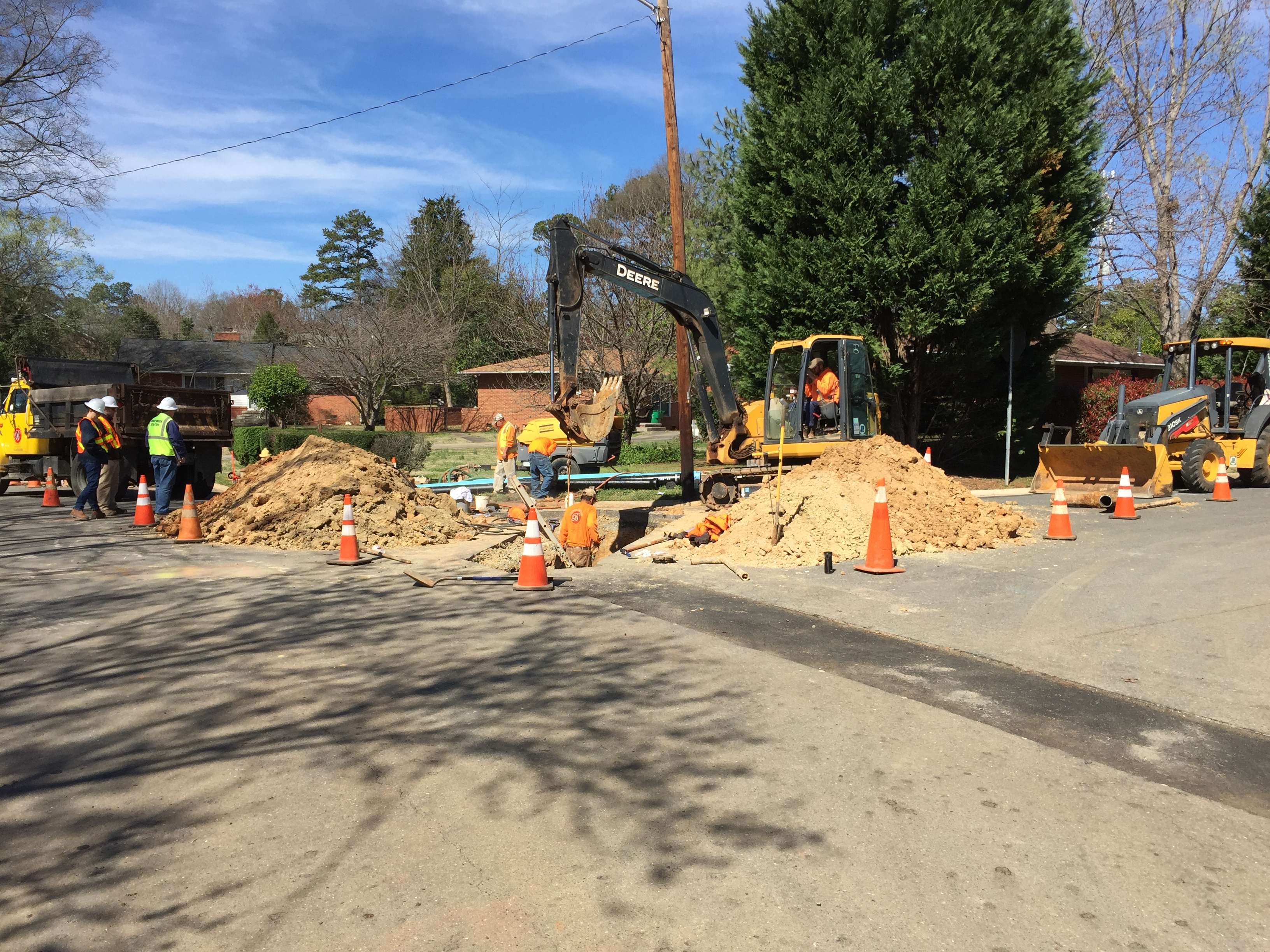 CHarlotte Water crew replacing an existing water pipe with new pipe.
