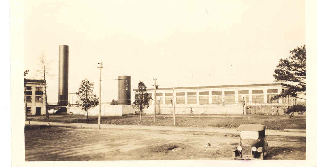 Historic Photo of the Outside of the Vest Wastewater Plant in the 1920s with old car parked next door.