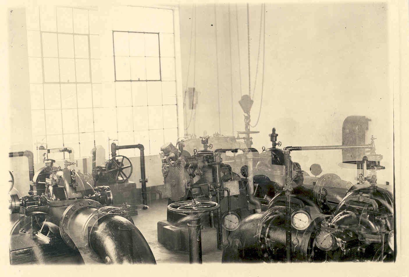 A historic photo of the inside of the Vest Wastewater Plant in the 1920's. These devices controlled water flow and chemicals.