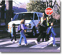 Picture of children crossing the street at crosswalk for Wheels for Learning Program