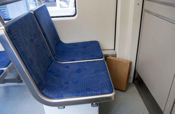 Image of package left alone on train