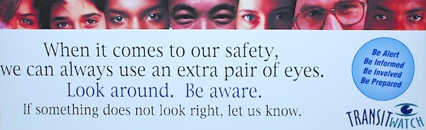 "Banner that says ""When it comes to our safety, we can aleays use an extra pair of eyes. Look around. Be aware. """
