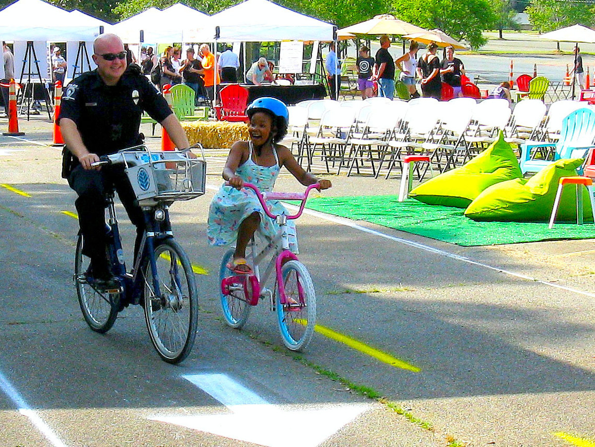 Police officer and young girl riding bikes